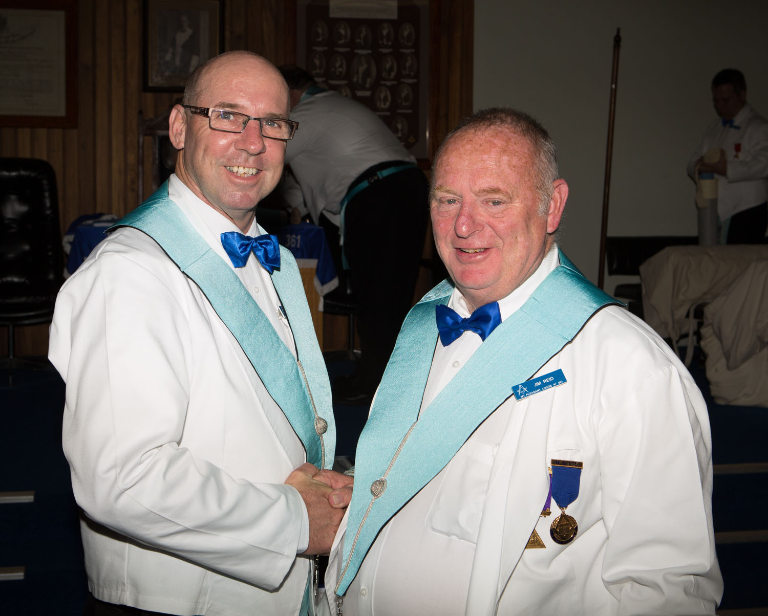 Bro Chris Eades being congratulated by the WM on being invested as Inner Guard