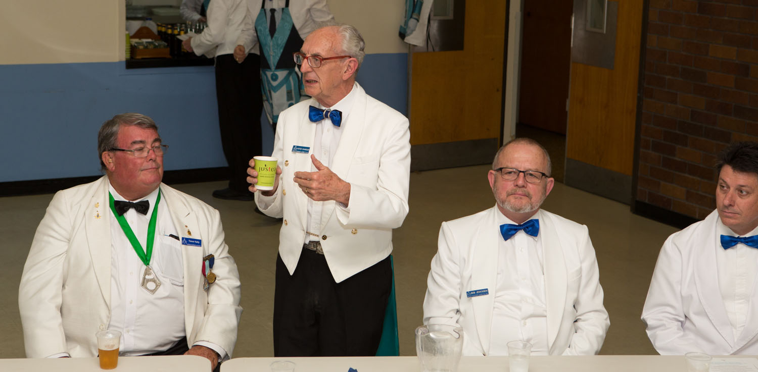WBro Chandler giving the absent brethren toast